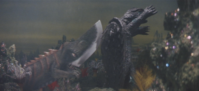 File:Gamera - 5 - vs Guiron - 40 - Gamera gets sneak attacked by Guiron.png