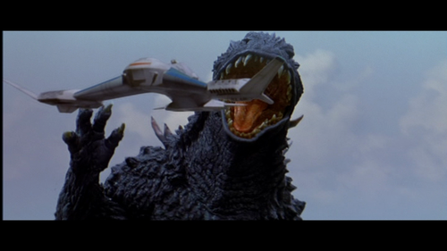 File:Godzilla tries to eat Griffon.png