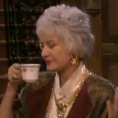 Dorothy drinking tea.