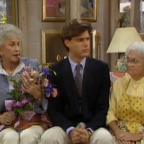 Dennis Drake as Dennis sitting between his mother in-law <a href=