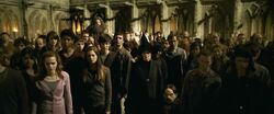 Hogwarts students raising wands