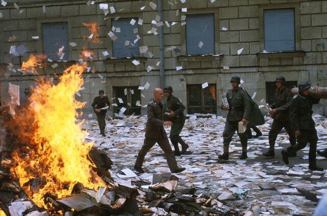 File:Schenck walks paper burning.jpg