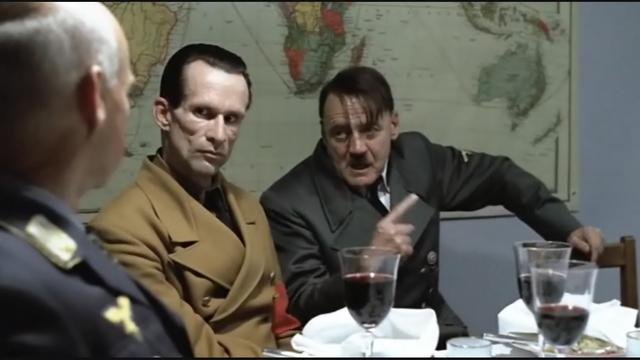 File:Hitler Explains scene hand gesture 2 goebbels stares.png