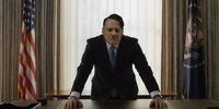 Hitler stands at the desk