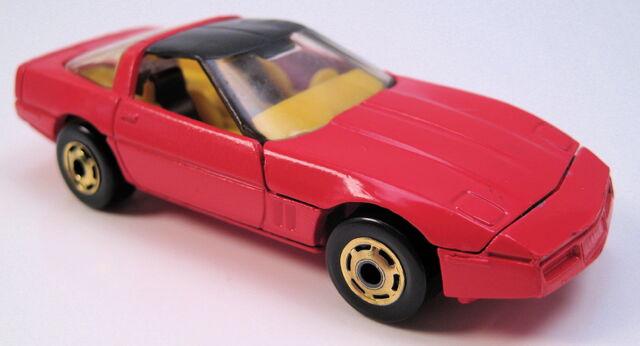 File:80s corvette red yellow interior gold HO wheels HK base black roof.JPG