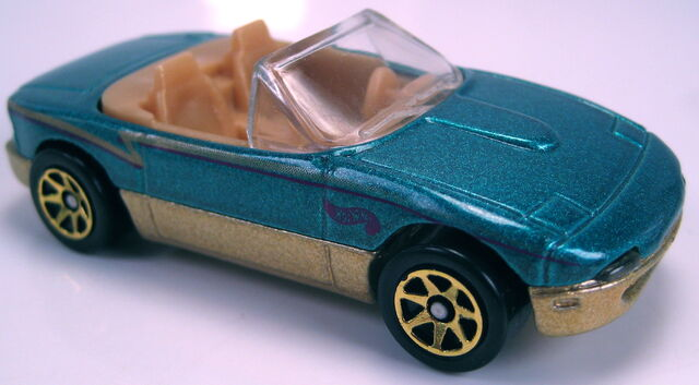 File:Mazda mx5 miata aqua metallic gold base gold 7sp TRU 10 pack 1997.JPG