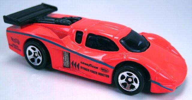 File:GT Racer neon orange tampos 5sp wheels.JPG