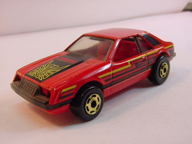 File:1983 turbo mustang metalflake red raised HK.jpg