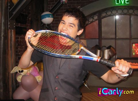 File:David bites a tennis racket..jpg