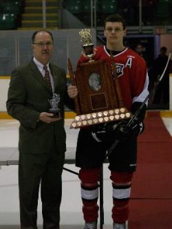 Taylor Dickin receives the Steve Boomer Hawrysh Memorial Award from Commissioner Kim Davis