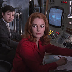 Helga and her boss being called for report by Blofeld
