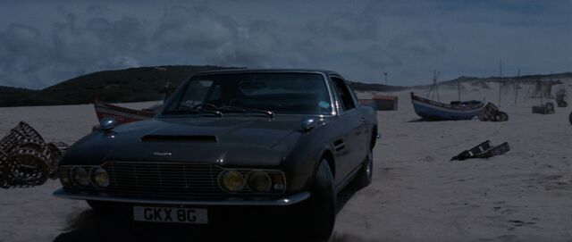 File:On Her Majesty's Secret Service - Bond pulls up on the beach in his DBS.jpg