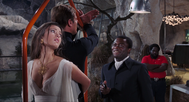 File:Live and Let Die - Kananga prepares to lower Bond into the shark pool.png