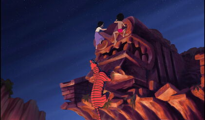 Mowgli and Shanti are both climbing up the statue to get away from Shere Khan the Tiger