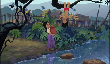 Shanti is looking at Mowgli who's upside down