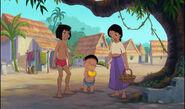 Mowgli and Shanti are both watching Ranjan eat