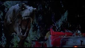 File:Tyrannosaurus Chasing Jeep.jpg