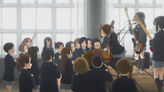 Yui about to jump down the stage