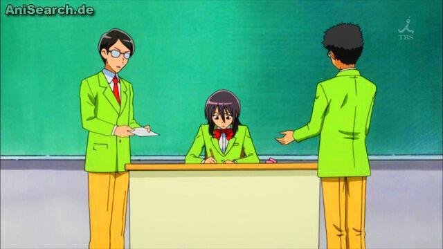 File:Misaki does paperwork.jpg