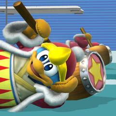 Rey Dedede sentado junto a la Entrenadora de Wii Fit