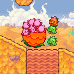 Kirbys usando una planta para rodar.