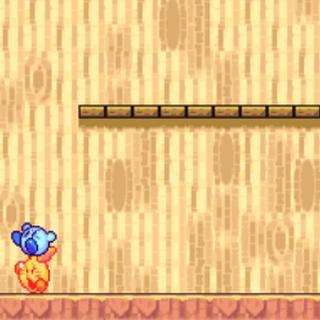 Kirby golpeando a un Brotín.