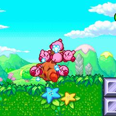 Varios Kirbys atacando a un enemigo.