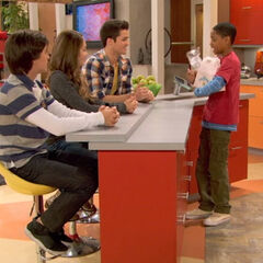 Leo giving Adam, Bree and Chase breakfast