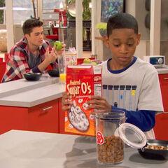 Leo mixing power pellets in Adam's cereal