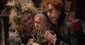 Helena-boham-carter-sacha-baron-cohen-and-isabelle-allen-in-les-miserables-2012