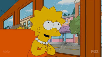 Lisa Simpson prays to Buddha,