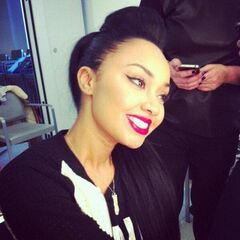 Leigh Anne's straight, long, black hair in pompadour ponytail