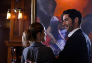 112 promo Lucifer Chloe looking at painting