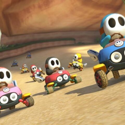 Many different colored Shy Guys racing in the <a href=