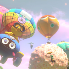 Lakitu, gliding past the princesses' balloons.