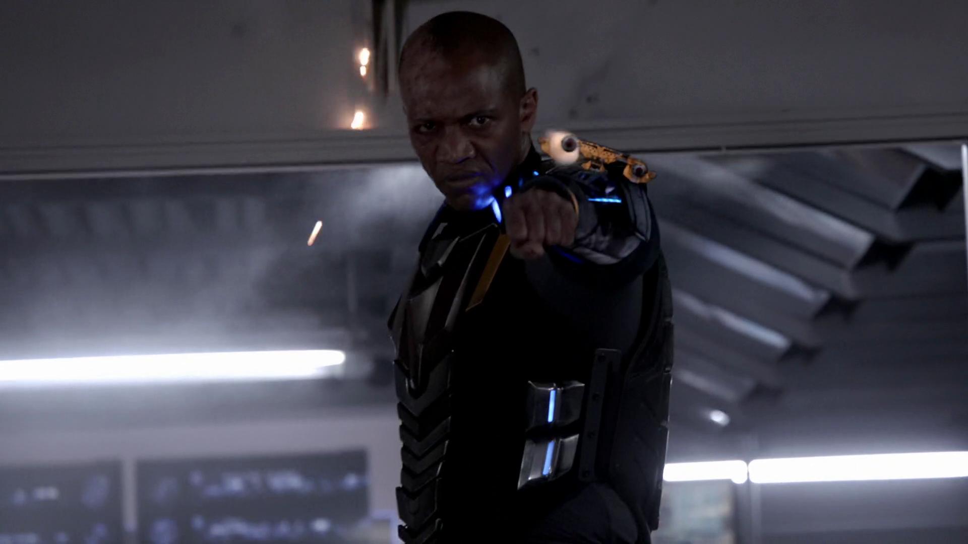 Deathlok fires at Coulson and  Agents Of Shield Deathlok Leg