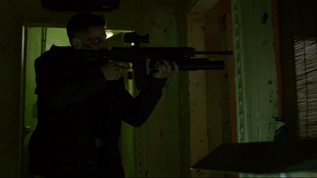 File:Punisher uses his gun.png