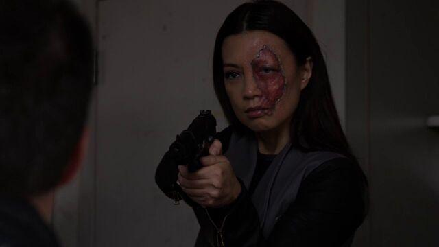 File:Agent33-aims-gun-at-Ward.jpg
