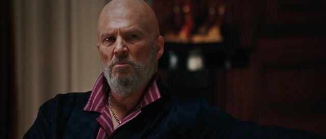 File:Obadiah-Stane-watches-the-news.jpg
