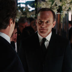 Coulson speaks to Stark at his Firefighter's benefit party