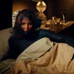 Mystique using her powers in front of Erik.