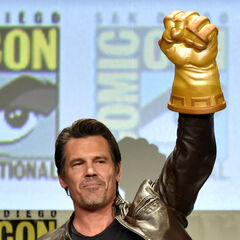 Josh Brolin with Infinity Gauntlet toy at San Diego Comic Con 2014.