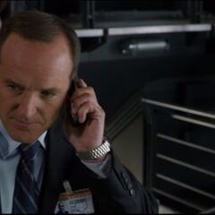 Agent Coulson talking with Natasha.
