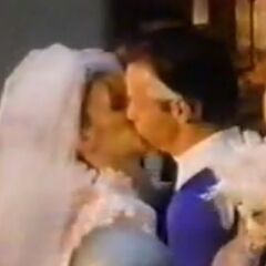 Sue kisses her new husband Reed Richards