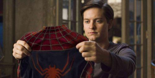 File:Peter-parker-holding-spider-man-suit.jpg