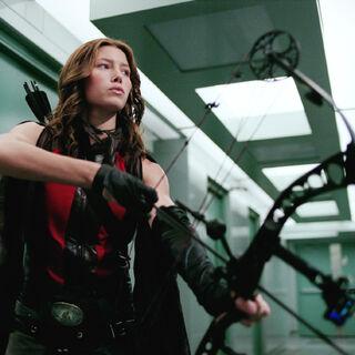 Abigail wielding her bow.