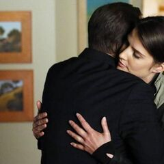 Maria Hill and Phil Coulson hugging.