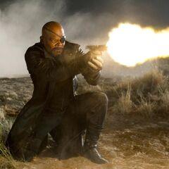 Nick Fury firing a gun.