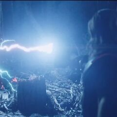 Thor striking Iron Man with his hammer.