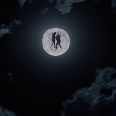 Azazel teleports the Man in Black high into the air.